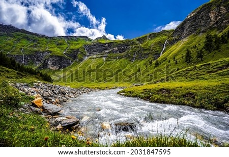 Mountain river in the valley. River valley in mountains. Mountain river valley landscape. Mountain river view