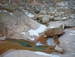 Mountain river in winter with ice on stone riverbanks, nature of Seoraksan National park, Korea