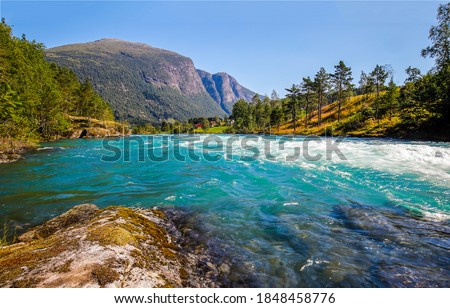Mountain river rapid landscape view. River rapid in mountain valley. River water flowing. Mountain river landscape