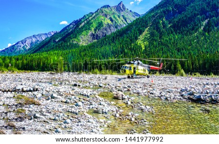 Mountain river valley helicopter scene. Helicopter on mountain river valley. Mountain river valley helicopter. Mountain river helicopter