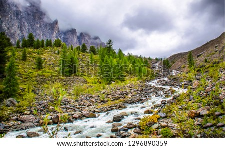 Mountain river valley landscape. Cloudy sky mist mountain river valley view. Mountain river stream valley scene. Mountain river stream