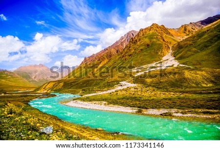 Mountain river valley landscape. Mountain river in mountain green valley panorama. Beautiful mountain river valley view