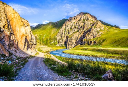 Mountain river valley road landscape. River valley in mountains. Mountain river valley view