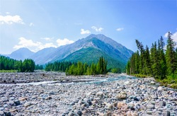 Mountain river valley stones landscape. River valley in mountains. Mountain river valley panorama