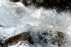 Mountain river. Waterfall in the Alps. Splashing water.