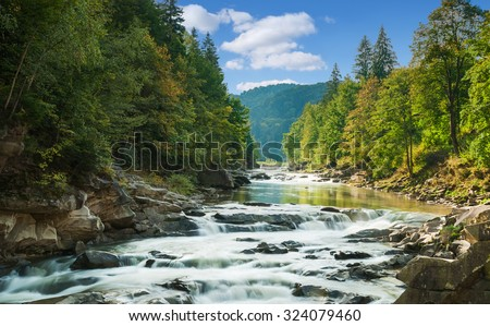 mountain river with waterfall #324079460