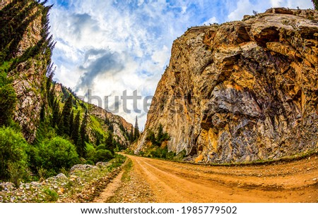 Mountain road among the rocks. Mountain canyon road. Road in mountains