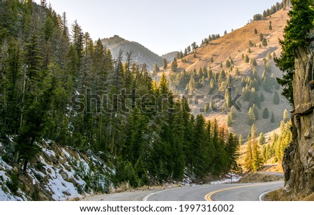 Mountain road among the rocks. Mountain road turn. Winding mountain road. Mountain road landscape