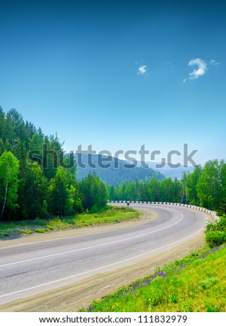 Mountain road and blue sky.