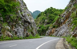 Mountain road at Cat Ba Island in North of Vietnam. Cat Ba is an well-known archipelago with a spectacular array of sea and island scenery.