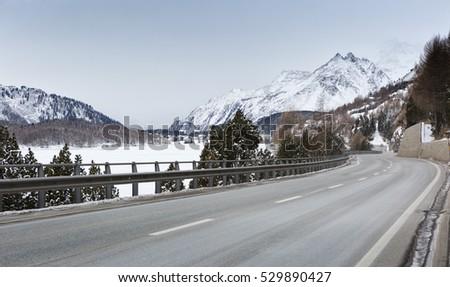 Mountain road in an overcast winter day (Swiss alps). Val Bregaglia,  canton Graubunden, Switzerland
