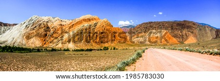 Mountain road in the canyon valley. Panorama of mountain valley road. Mountain valley road panoramic landscape. Mountain road panorama