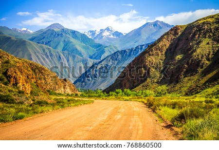 Mountain road spring ranges landscape. Mountain hill road panorama #768860500