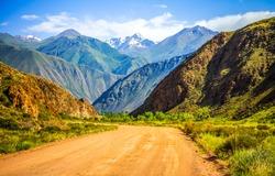 Mountain road through the hill range landscape