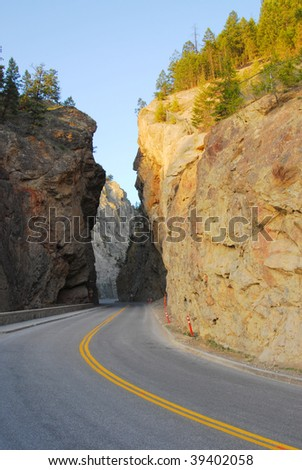 Mountain road through the west gate canyon in the kootenay national park, radium hot springs, british columbia, canada