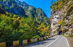 Mountain road tunnel view. Tunnel road in mountains. Mountain road tunnel landscape