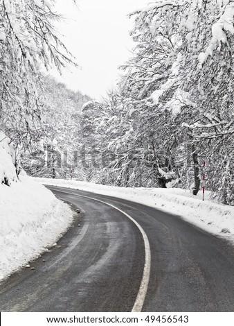 mountain road with snow - stock photo