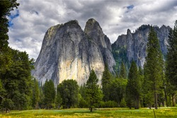 Mountain rocks in forest view. High rocks in mountain forest. Mountain forest high rocks