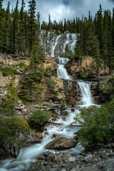 MOUNTAIN RUN OFF WATER FALLS DOWN LONG ROCKY SLOPE DIRECTLY BESIDE HIGHWAY 93 - JASPER NP