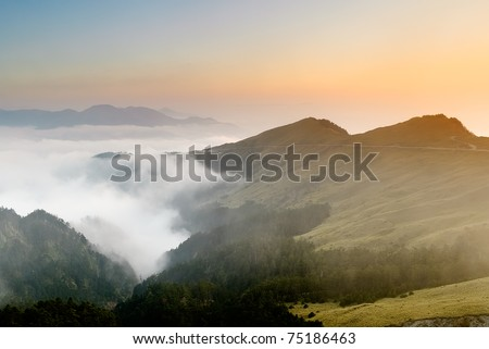 Mountain scenery with attractive sunset and clouds, Mt. Hehuan(Hohuan) in Taroko National Park, Taiwan, Asia.