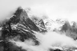 Mountain (Schreckhorn) slowly appearing through the mist, Grindelwald, Switzerland
