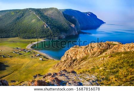 Mountain sea bay beach landscape. Blue lagoon in mountain sea bay. Mountain sea bay village. Mountain sea bay lagoon