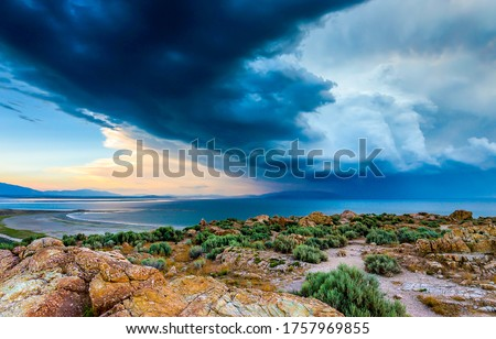 Mountain sea bay stormy clouds. Storm clouds sea bay landscape. Sea bay storm clouds view