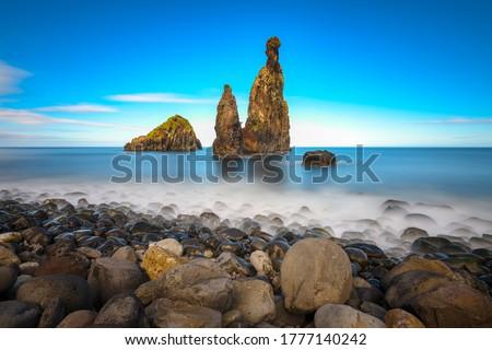 Mountain sea pillar rocks view. Sea rock landscape. Rocks in sea
