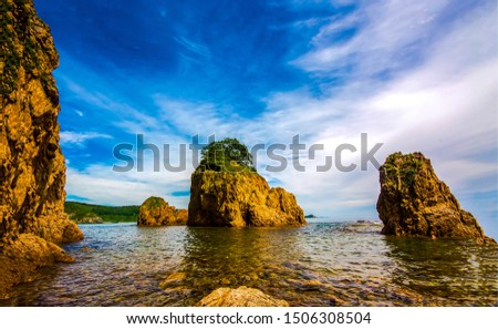 Mountain sea rocks landscape. Sea rock view. Mountain sea rocks scene. Sea rocks in water