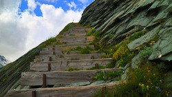 Mountain side stairway in the alps mountains. Looks like the stairway to heaven.