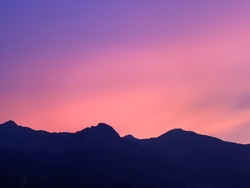 Mountain silhouette with a stunning light variation