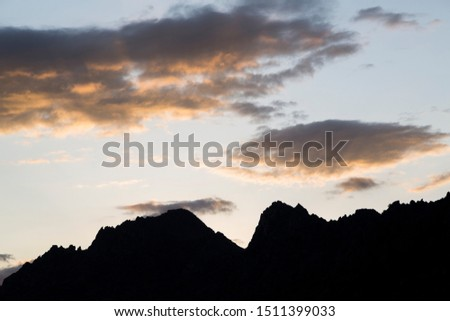 Mountain silhouette with blue and cloudy sky north of Madrid in La Cabrera.