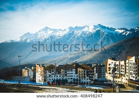 Shutterstock Mountain ski resort with snow in winter. Rosa Khutor, Sochi, Russia.