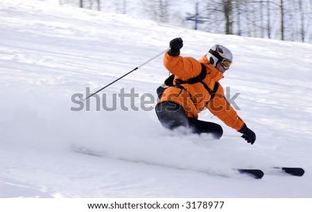 mountain ski rider in orange sharp turn