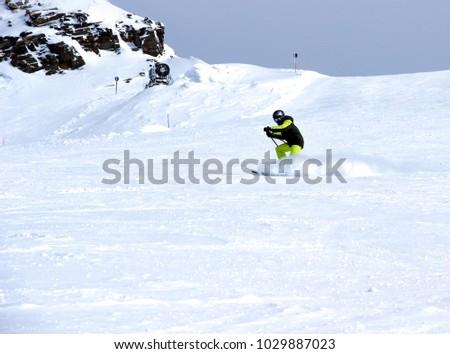 Mountain skiing, child boy skiing down the mountain #1029887023
