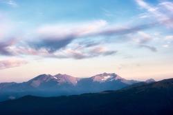 Mountain snow peaks sunset landscape. Caucasian mountains of the Republic of Adygea, Krasnodar region
