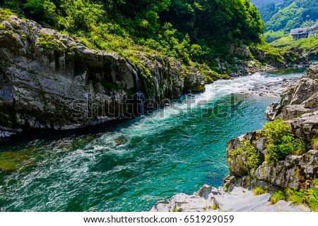 Mountain stream and landscape Japan Asia #651929059