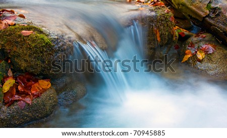 mountain stream in autumn time