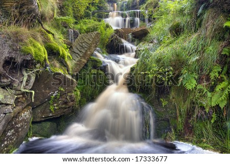 Mountain stream waterfall cascading over rocks