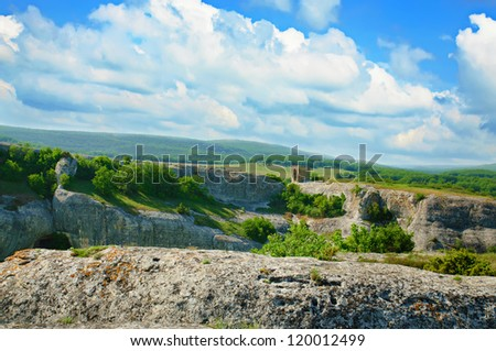 Mountain summer landscape (Eski-Kermen) with clouds and green hills #120012499