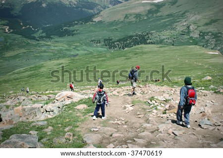 Mountain Summit Hikers Summer. Colorado Summer Mountain Backcountry Scene. Great for themes of nature, summer, mountains, outdoor recreation, travel destinations, background scenic.