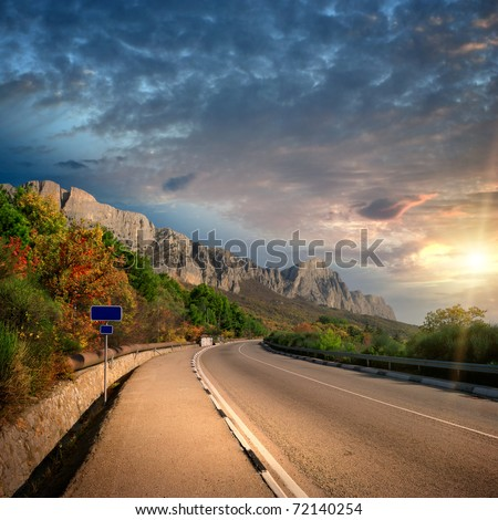 mountain sunset and road without cars