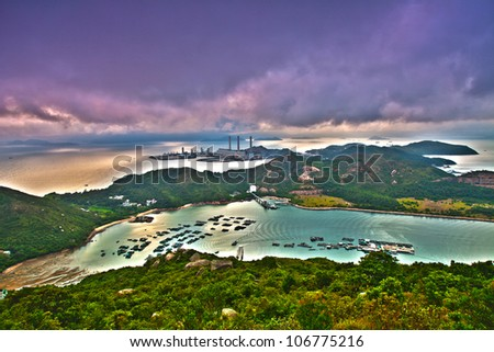 Mountain sunset in island with power plant