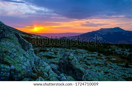 Mountain sunset sky clouds landscape. Sunset in mountains. Mountain sunset landscape. Mountain sunset sky view