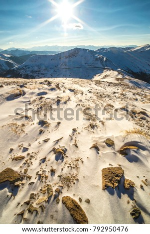 Mountain top view continental divide vertical sunset rays beautiful snow rocky mountains colorado