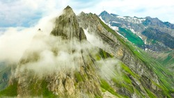 Mountain Top view with clouds nature with other mountains. Aerial view High Definition photo.