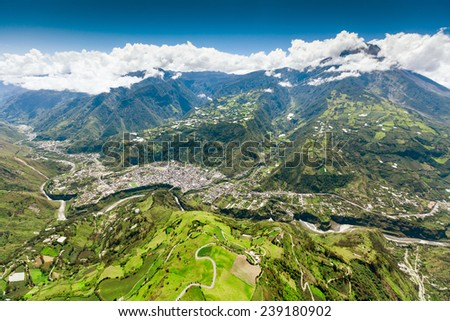 mountain town from aerial shot of banos de agua santa claus nne to sww tungurahua volcano in the scene and pastaza waterway in foreground mountain town from volcanoe building canyon vacation nature ac Stock fotó ©