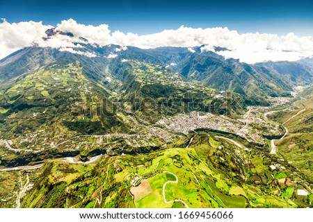 mountain town from aerial shot of banos de agua santa nne to sww tungurahua volcano in the background and pastaza river in foreground mountain town from volcanoe volcano building canyon vacation earth Stock fotó ©