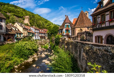 Mountain town houses in summer. Tonw in mountains. Town houses in European mountains