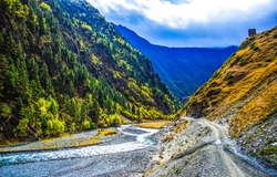 Mountain trail and stream in the mountains. Mountain canyon landscape. Mountain stream canyon. Mountain gorge landscape